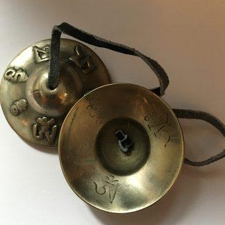 Beautiful Tibetan Buddhist Hand Bells on leather cord; 62mm diameter