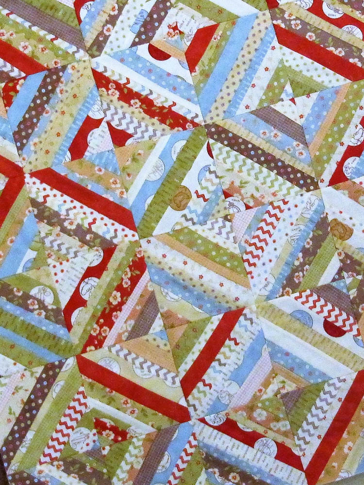 Strings quilt made with two  honey buns. Sometimes it is nice to use co-ordinated fabrics instead of scraps