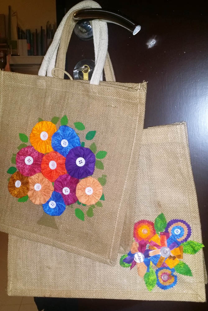 Decorated woolworths bag with yoyos