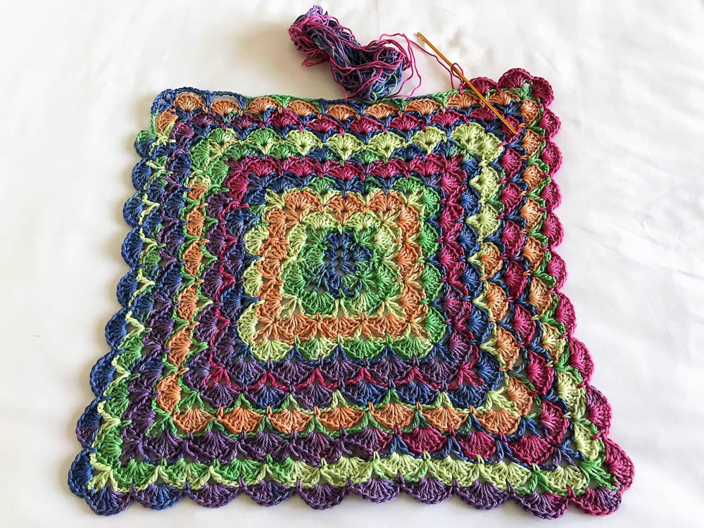 Crocheting a shells blanket, link to video tutorial in post.