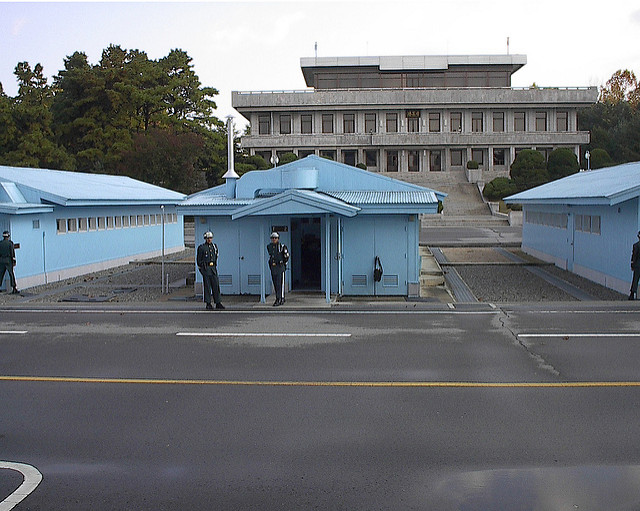 North and South Korean troops guard a hut where they signed the amistice