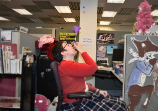 Photo of a librarian playing the floating ball activity