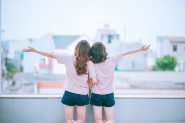 Photo of two girls holding hands