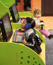 young children at library computers