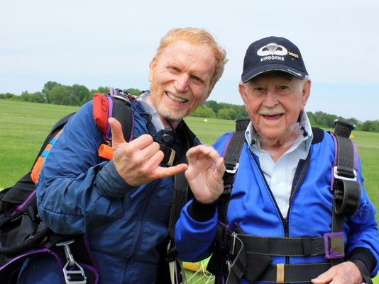 This photo provided by Skydive Warren County, Inc. shows Clarence Turner, 87, celebrating with instructor Jeff McGinnis after they parachuted in tandem at the Red Stewart Airfield near Waynesville, Ohio, on Saturday. (Photo: Elod Otbos, AP)