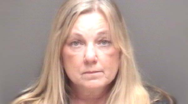 A mother was arrested and charged after she allegedly turned to WebMD.com, instead of seeking professional medical attention, when her 14-year-old son was shot by a friend playing with a gun, Santa Fe police said.