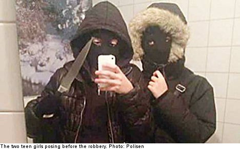 Two teenage girls suspected of robbing a restaurant have been tied to the crime after police seized images from their phones showing the pair posing before a mirror wearing balaclavas and holding a knife.