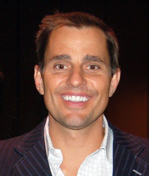 bill rancic proposed in a helicopter flying over Chicago