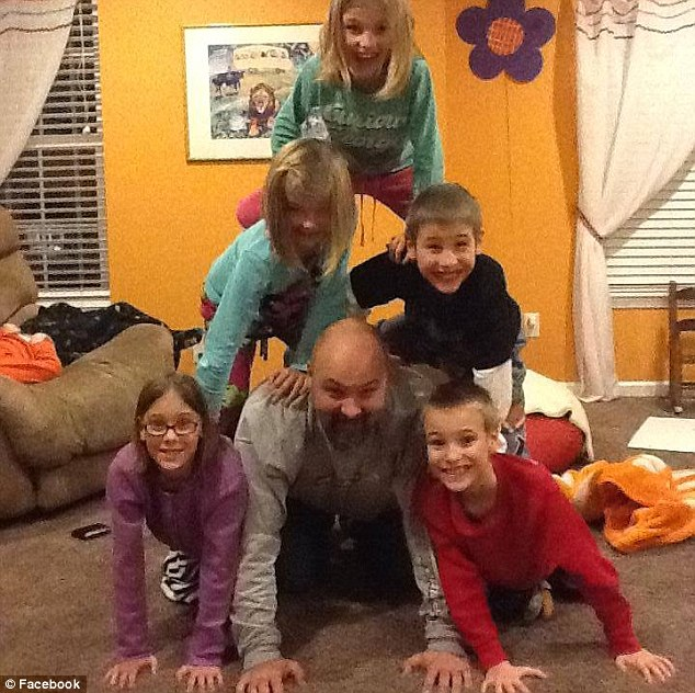 Ben Van Houten, pictured with five of his seven children at their home in January. The 39-year-old father and church deacon died suddenly while playing with his children on Wednesday night