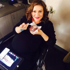 Pregnant Alyssa Milano eating ice cream on set of her ABC series Mistresses Credit: Courtesy Alyssa Milano