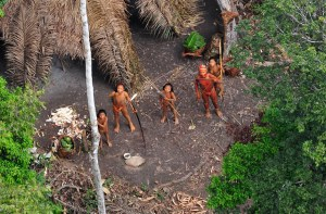 (FILES) Undated handout picture released January 31, 2011 by Survival International of uncontacted Indians seen from a Brazilian government's observation aircraft in the Brazilian Amazon forest, near the border with Peru. The Brazilian government on August 13, 2011 sent eight members of their National Security Force police elite unit --whilst awaiting for the arrival of Army troops-- to protect a group of isolated natives presumably  attacked by drug traffickers or by paramilitary groups, authorities said.   AFP PHOTO/Gleison Miranda/FUNAI/Survival - FOR DETAILS GO TO : www.uncontactedtribes.org - RESTRICTED TO EDITORIAL USE - MANDATORY CREDIT - NO MARKETING NO ADVERTISING CAMPAIGN - DISTRIBUTED AS A SERVICE TO CLIENTS (Photo credit should read Gleison Miranda/AFP/Getty Images)