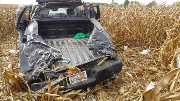This photo provided by the Wyandot County, Ohio, Sheriff, investigators examine the wreckage of a pickup truck that crashed in a cornfield near Upper Sandusky, Ohio on Sunday, Oct. 12, 2014, killing Andrew Bloomfield and seriously injuring his wife. Bloomfield had married 37-year-old Ruth Driskill hours before the accident. A 26-year-old friend, Elizabeth Shelton, also died in the crash. (AP Photo/Wyandot County Sheriff) Close