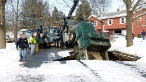 Sinkhole snowplow:  Sinkhole Swallows Snowplow in New Jersey