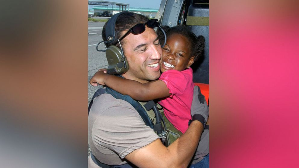 AIRMAN 1ST CLASS VERONICA PIERCE/AIR FORCE Then Master Sgt. Mike Maroney gets a big hug from the little girl he rescued along with her family in Hurricane Katrina's aftermath. Ten years later, he hopes to find out whatever happened to her.
