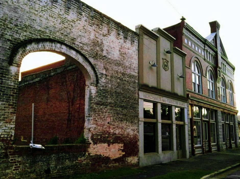 """This Oct. 1, 2013 photo shows the archways and brick wall of an old building in Grantville, Ga., that is used to film a scene in the AMC TV drama ¨The Walking Dead"""" Tourists come to the west Georgia town to see the wall and other nearby buildings where scenes from the show were filmed."""