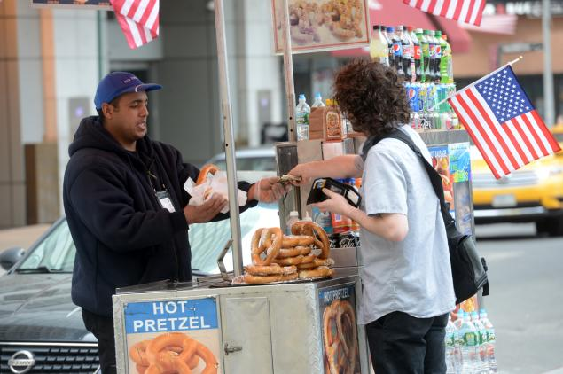 SUSAN WATTS/NEW YORK DAILY NEWS Food cart vendor Ahmed Mohammed sells at Greenwich and Albany Sts. and was caught on camera charging as much as $30 for a hot dog and a drink on Wednesday.