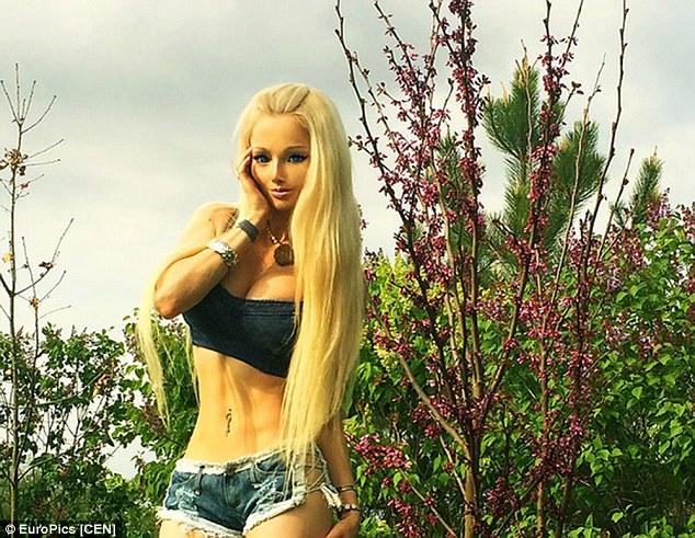 Valeria Lukyanova shows off Her abs:  Human Barbie Has Sweet Six Pack