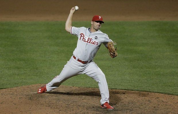 Philadelphia Phillies relief pitcher Jeff Francoeur throws to the Baltimore Orioles in the eighth inning of an interleague baseball game, Tuesday, June 16, 2015, in Baltimore. Baltimore won 19-3. (AP Photo/Patrick Semansky)