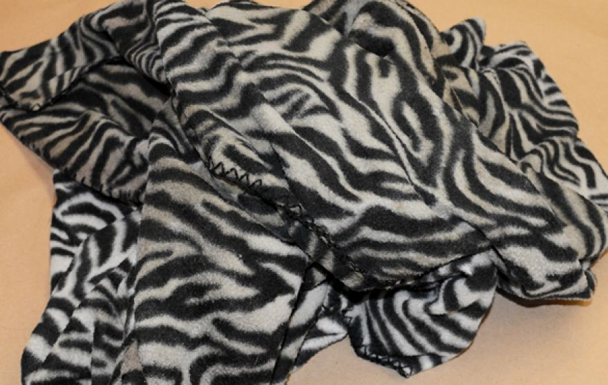 """This photograph shows a blanket found with the child's body. It is a black and white zebra print manufactured by """"Cannon."""" (Suffolk County District Attorney's Office)"""