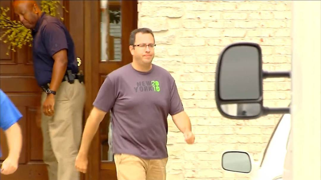Jared Fogle is seen outside of his home as the FBI searched the house.