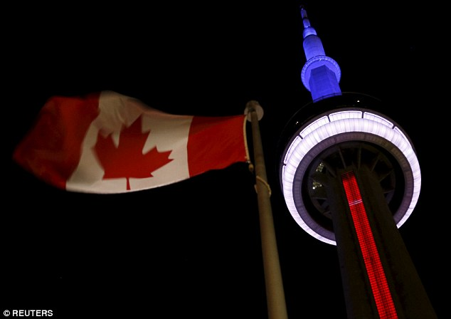 Cities Paris tributes The landmark CN Tower is lit blue, white and red in the colors of the French flag following Paris attacks, in Toronto