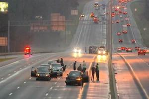 State troopers investigate a series of accidents involving at least 90 vehicles Sunday on I40/I85 near Burlington, North Carolina. Rich Cisney — WXII-TV
