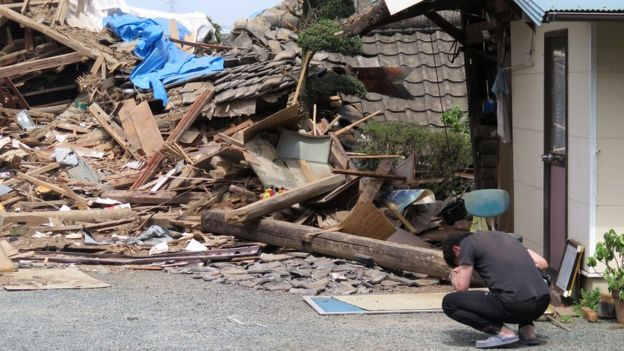 Thousands of rescue workers are being deployed in the Kyushu region of south-western Japan to locate victims of a powerful earthquake