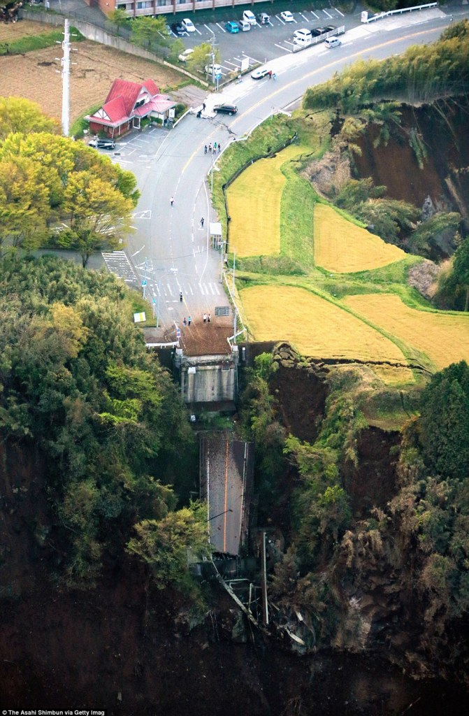 Challenging: Rescue efforts have been made more difficult by the fact that landslips have destroyed roads and bridges in the region