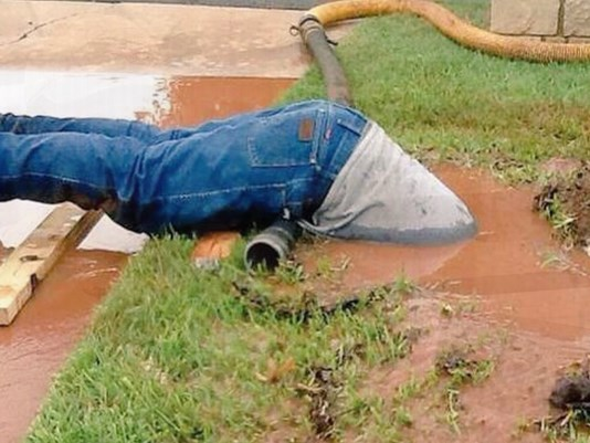 Photo Surfaces of Utility Worker Submerged Up to His Waist