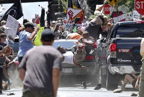Car drives into protest crowd and kills person – US white supremacy protests