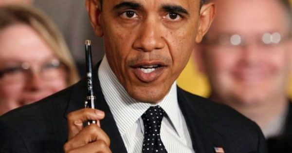 obama-with-pen-1024x536