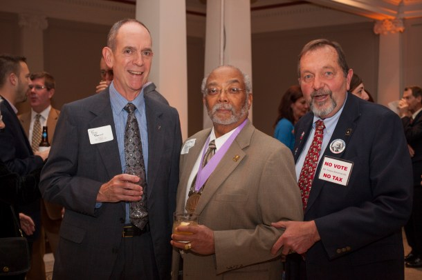 The Association of the Oldest Inhabitants president Bill Brown, left, and Nelson Rimensynder, right, with 2013 award honoree Rohulamin Quander.