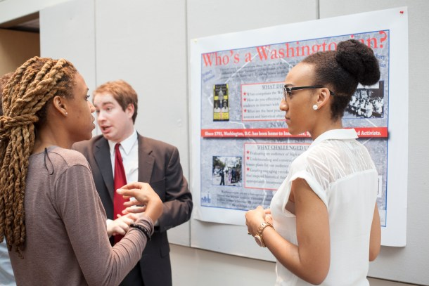 "Zach Klitzman and Sydney Johnson present their poster on developing lessons on ""Who's A Washingtonian,"" at Public History Day at American University."