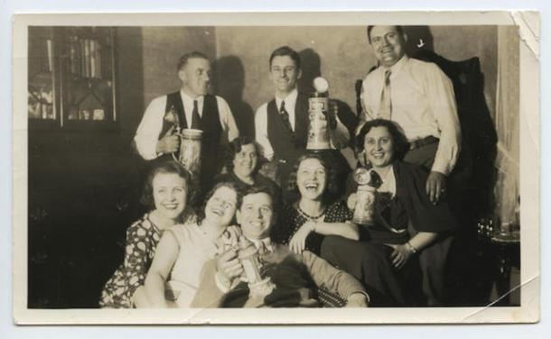 Laughing employees of the Christian Heurich Brewing Company hoist beer steins.