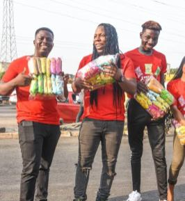 Edem selling 2 - Photos & Video: Rapper Edem Spotted Selling In Traffic
