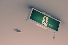 Green Exit Sign On Ceiling