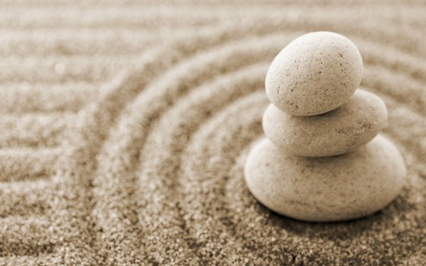 zen stones in rings of sand, a peaceful beach scene