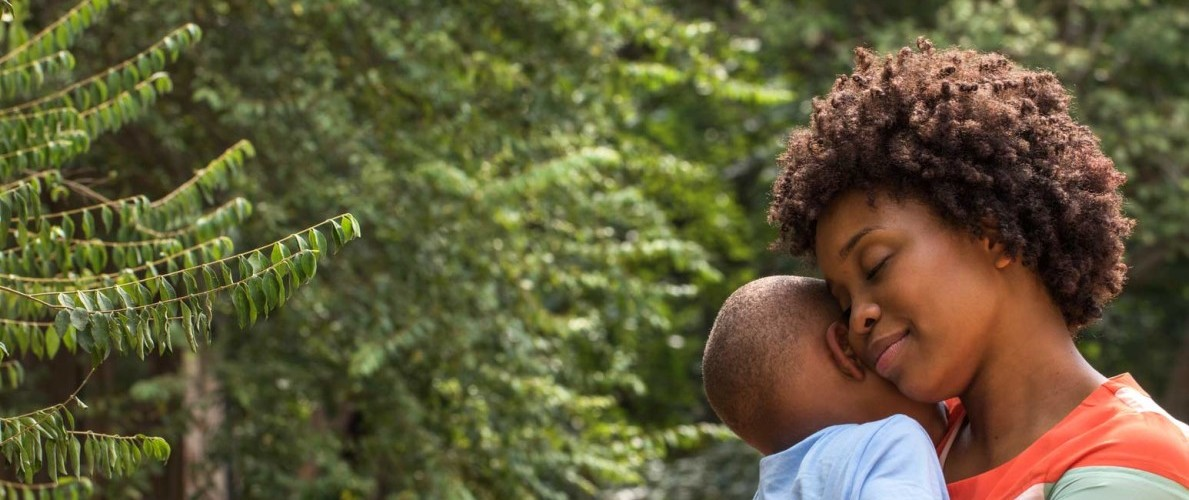 African American woman holding young son