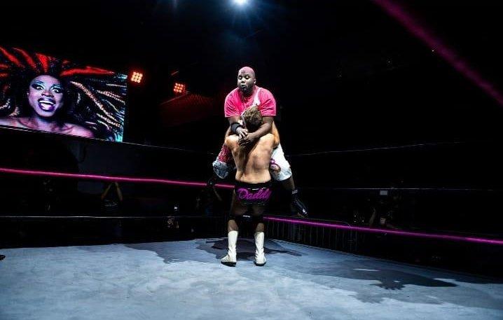 Two men wrestling in a wrestling ring