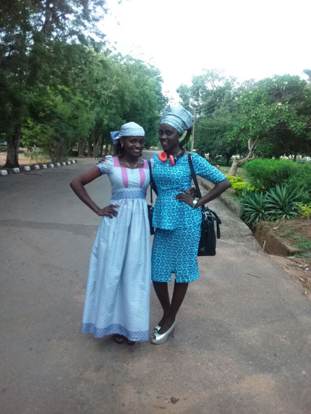 They are sisters of the BUD. Adeyoola (right) and Mama Abidemi (left). Blue is beautiful. The green behind them is wow!...Natural scene!...The Headphone compliments Mama Bidex's neckline right?...Lol...I could be analytical tho!