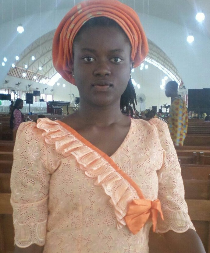 She is intelligent, gentle, unique and wonderful. Her name is Comfort. Simple style...very nice gele. Love you loads