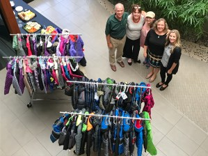 Coats were needed for The Kinship House, an organization that provides resources for children within the foster care system and/or going through the adoption process.
