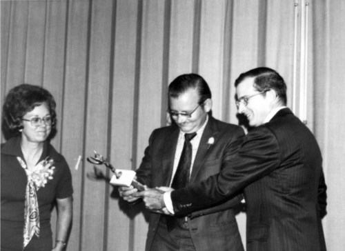 Lloyd receives an award for his involvement in the creation of Texas Commission for the Deaf, (TCD)