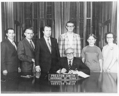 Signing Ceremony - Jim Scoggins (L), poses with Lloyd Bridges, as Representative John Boyle, Senator Jack Hightower, Bobbie Beth Bridges, and Martha Pruitt watch Governor Preston Smith sign into being, House Bill 1293 creating a State Commission for the Deaf on June 4th, 1971