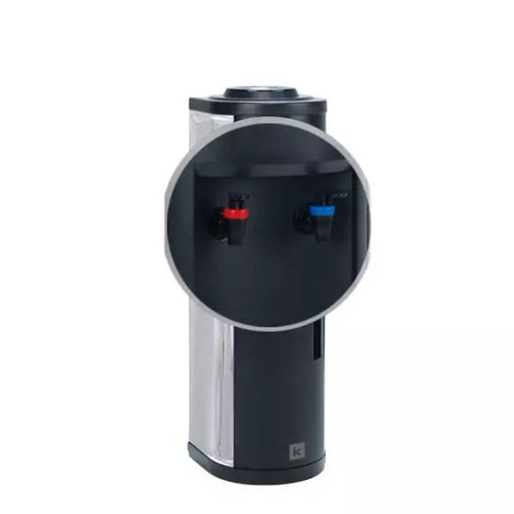 Vista detalle de los grifos surtidores del dispensador con botella INOX