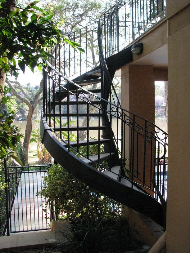 10 Stunning Wrought Iron Staircase Designs | Exterior Iron Stair Railing | Steel | Exterior Ramp | Cheap | Wood | Contemporary