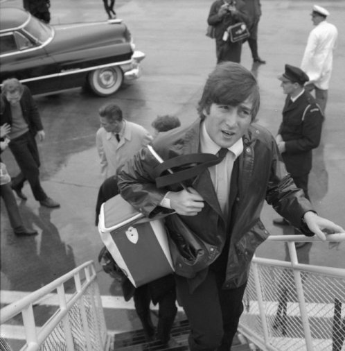 John Lennon boards a Viscount aircraft for a domestic flight at Wellington Airport, June 23, 1964. The capital's airport did not have jet bridges for domestic flights until the late-'80s, so you were invariably guaranteed a soggy boarding