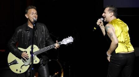 "Depeche Mode's Martin Gore and Dave Gahan performing ""Personal Jesus"" at the MAP/MusiCares fundraiser in Los Angeles, in 2011"