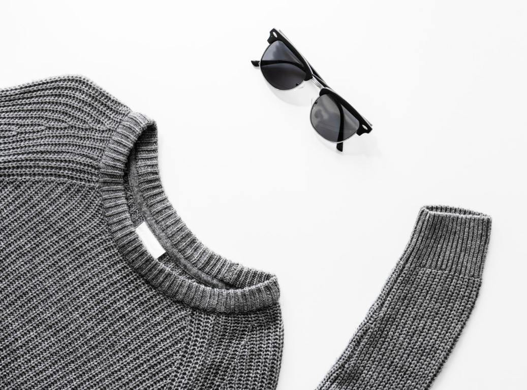 a sweater and sunglasses