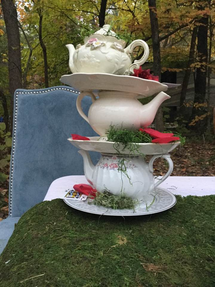 Whimsically stacked tea pots